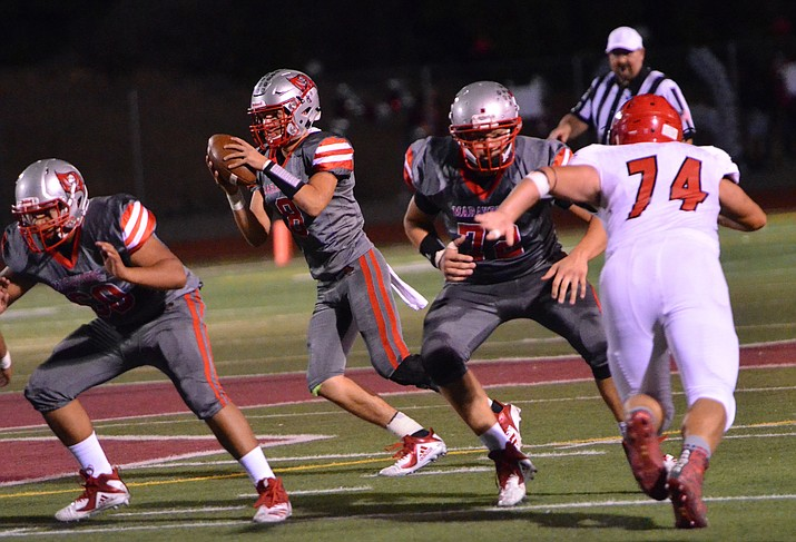Mingus senior Antoine Zabala receives a snap during the Marauders' 48-14 win over Lee Williams on Sept. 21. Zabala leads the region in passing. VVN/Vyto Starinskas.