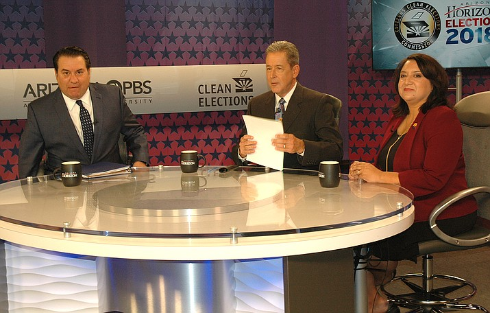 Mark Brnovich, left, and January Contreras face off Wednesday night in a televised debate for attorney general with KAET host Ted Simons. (Capitol Media Services photo by Howard Fischer)