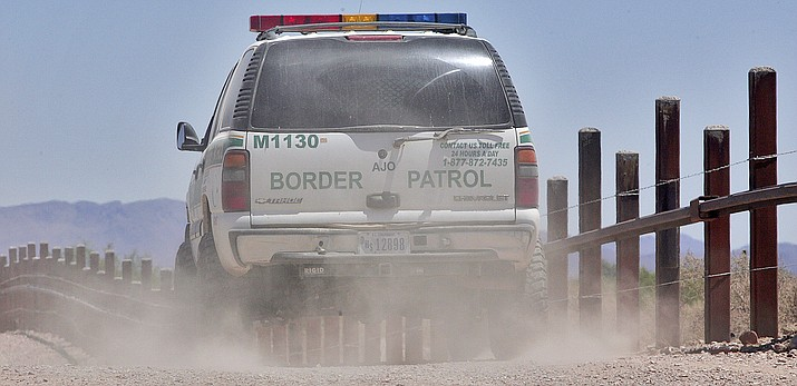A U.S. Border Patrol agent patrols the international border separating Sonoyta, Mexico, right of fence, and Lukeville, Ariz., May 26, 2006, in Organ Pipe Cactus National Monument. (Matt York/AP file)