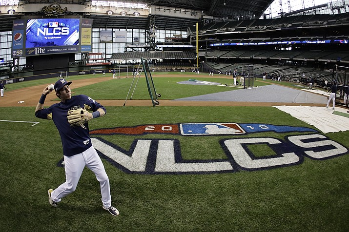 Milwaukee Brewers' Christian Yelich warms up for practice for Game 1 of the National League Championship Series baseball game Los Angeles Dodgers Thursday, Oct. 11, 2018, in Milwaukee. (Matt Slocum/AP)
