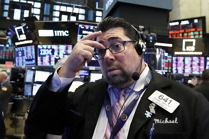 Trader Michael Capolino works on the floor of the New York Stock Exchange, Thursday, Oct. 11, 2018. The market's recent decline was set off by a sharp drop in bond prices and a corresponding increase in yields last week and early this week. (Richard Drew/AP)