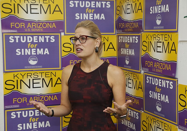 Democratic Rep. Kyrsten Sinema, who is running against Republican Rep. Martha McSally for the open Arizona Senate seat Jeff Flake, R-Ariz., is vacating, talks to campaign volunteers, Tuesday, Oct. 2, 2018, in Tempe, Ariz. Arizona's Senate race pits Sinema, a careful politician running as a centrist in a Republican-leaning state, against McSally, a onetime Trump critic turned fan. (Ross D. Franklin/AP)