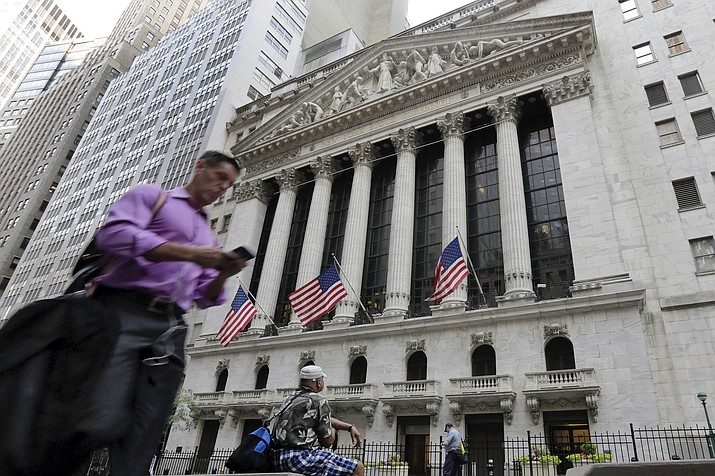 In this June 24, 2016, file photo, a man walks by the New York Stock Exchange. The U.S. stock market opens at 9:30 a.m. EDT on Friday, Oct. 12, 2018. (AP Photo/Richard Drew, File)