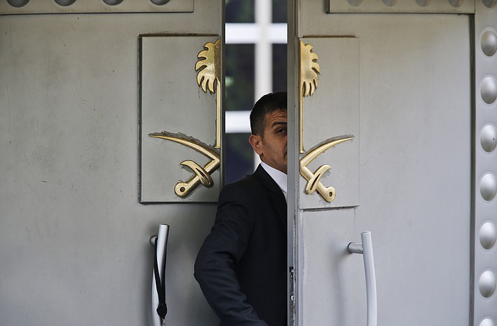 In this Tuesday, Oct. 9, 2018 file photo, a security guard walks in the Saudi Arabia consulate in Istanbul, Turkey. The Trump administration's ongoing courtship of Saudi Arabia is on pause over allegations that the key U.S. ally is involved in the mysterious disappearance of a Saudi writer and dissident who went into his nation's consulate in Turkey but never came out. (AP Photo/Lefteris Pitarakis, File)