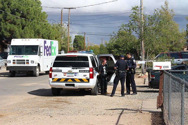 Police arrest Derek Deverne Ferrier, 30, of Kingman, after he led them on a chase through a neighborhood on his quad. Kingman Police Department vehicles blocked off the streets near Florence Avenue and Los Angeles Street. (Photo by Hubble Ray Smith/Daily Miner)