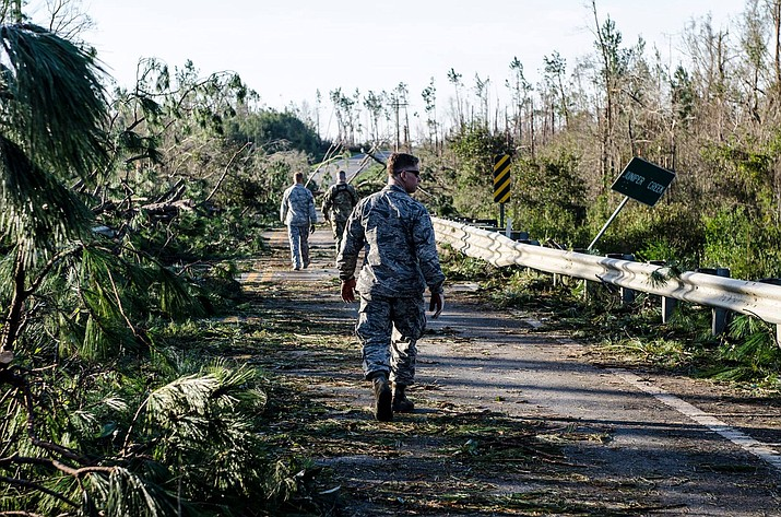 The Florida National Guard's Chemical, Biological, Radiological, Nuclear and high-yield Explosive (CBRNE) Enhanced Response Force Package (CERFP) reconnaissance team survey a hazardous roadway in Clarksville, Florida after Hurricane Michael passed through the area. (Photo by Staff Sgt. Carmen Fleischmann)