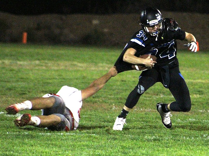 Kingman Academy's Charlie Anderson threw for 150 yards and added 40 rushing yards Friday night against River Valley. (Photo by Beau Bearden/Daily Miner)