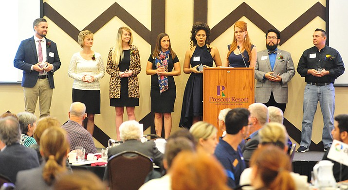 Prescott Area Young Professionals recognized 8 members with Visionary Awards during the 2018 Prescott Chamber of Commerce Business Awards ceremony Thursday, Oct. 11, 2018 at the Prescott Resort. From left, David Williams, Jaimie Sventek, Megan Smith, Rebekah Prieto, Alexes Niekamp, PAYP President Ariana Bennett, Eric Giler-Tomala and Jonathan Bennett. (Les Stukenberg/Courier)