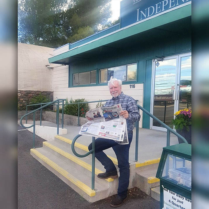 Randy Garrison, vice chair of the Yavapai County Board of Supervisors, holds a newspaper outside the Verde Independent in Cottonwood. (Vyto Starinskas/VVN)