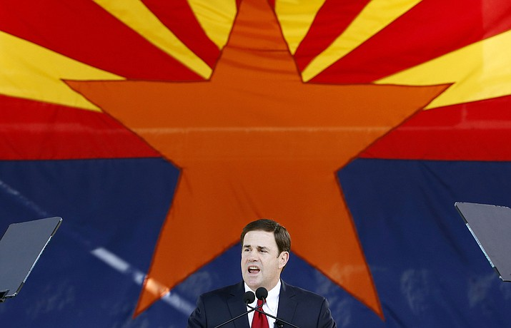 In this Jan. 5, 2015, file photo, Republican Arizona Gov. Doug Ducey addresses the crowd in Phoenix. Arizona will be home to a sprawling facility for researching the safety of self-driving cars, cementing the state's determination to invest in the technology. Ducey signed an executive order Thursday, Oct. 11, 2018, establishing the newly-created Institute for Automated Mobility. (Ross D. Franklin/AP, file)