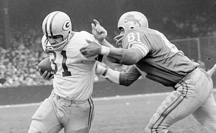 In this Nov. 22, 1962, file photo, Green Bay Packers fullback Jim Taylor (31) is brought down by Detroit Lions' Dick Lane in the third quarter of an NFL football game in Detroit. The Hall of Fame fullback died early Saturday, Oct. 13, 2018, the Packers announced. He was 83.  (Preston Stroup/AP, file)