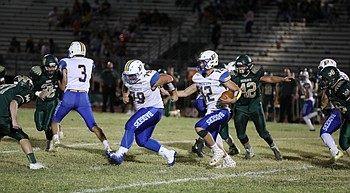 Austin Clark runs for 3 TDs, No. 11 Badgers beat Mohave 44-27 photo