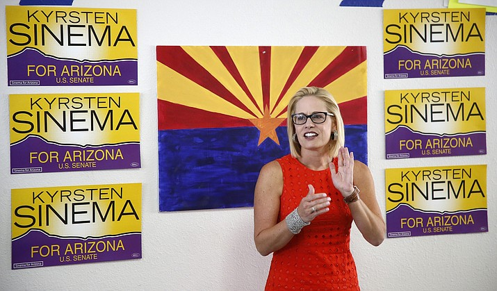 Rep. Kyrsten Sinema, D-Ariz., talks to campaign volunteers at a Democratic campaign office in Phoenix on Aug. 28, 2018. As the November elections near, Democrats are focusing on health care. It's a top issue in campaigns from Virginia to Nebraska to California, and especially in Arizona, where Sinema has made it the foundation of her Senate campaign. (Ross D. Franklin/AP file)