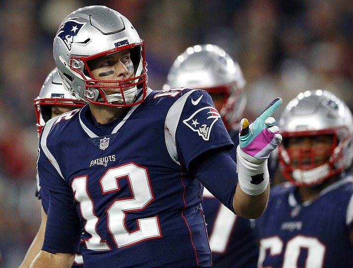 New England Patriots quarterback Tom Brady signals as he runs to the sideline after his team scored a touchdown during the second half of an NFL football game against the Kansas City Chiefs, Sunday, Oct. 14, 2018, in Foxborough, Mass. (Michael Dwyer/AP)