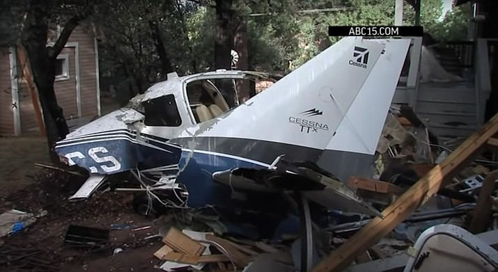 Police said Monday that the victims in the crash of a small plane into a home in Payson, Arizona have been identified as 63-year-old pilot Craig Raymond McEntee and 56-year-old passenger Marilee Marshall Brusaschetti. (Photo courtesy of ABC15 News via AP)
