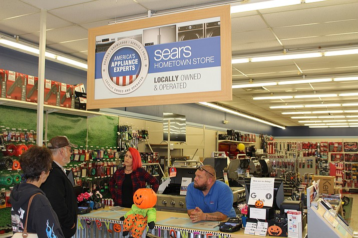 Mandy Suprian, center, helps a customer Monday at the Sears Hometown store in Kingman. Sears Hometown is a separate corporation from Sears Holding, which filed for bankruptcy Monday and announced plans to close 142 stores. (Photo by Hubble Ray Smith/Daily Miner)
