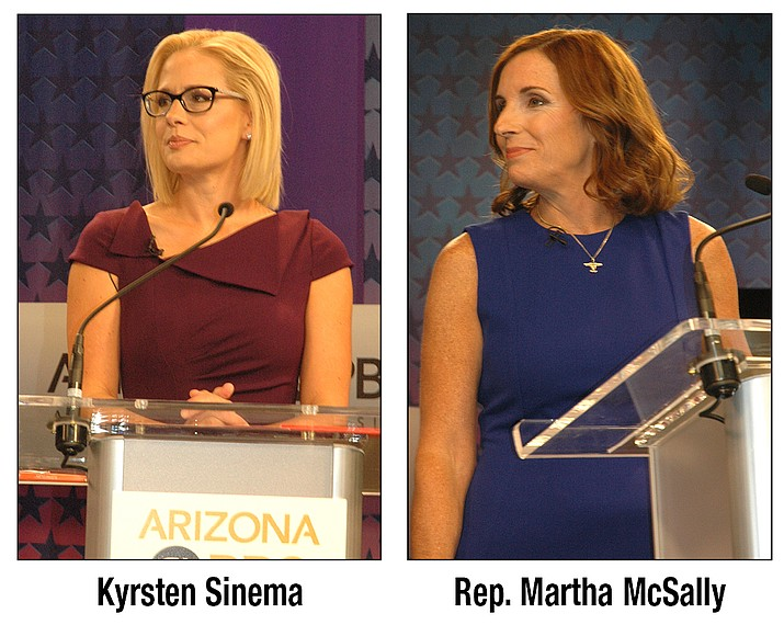Republican senatorial contender Martha McSally and Kyrsten Sinema, her Democratic foe debate in Phoenix Monday, Oct. 15, 2018. (Howard Fisher/special to the Courier)