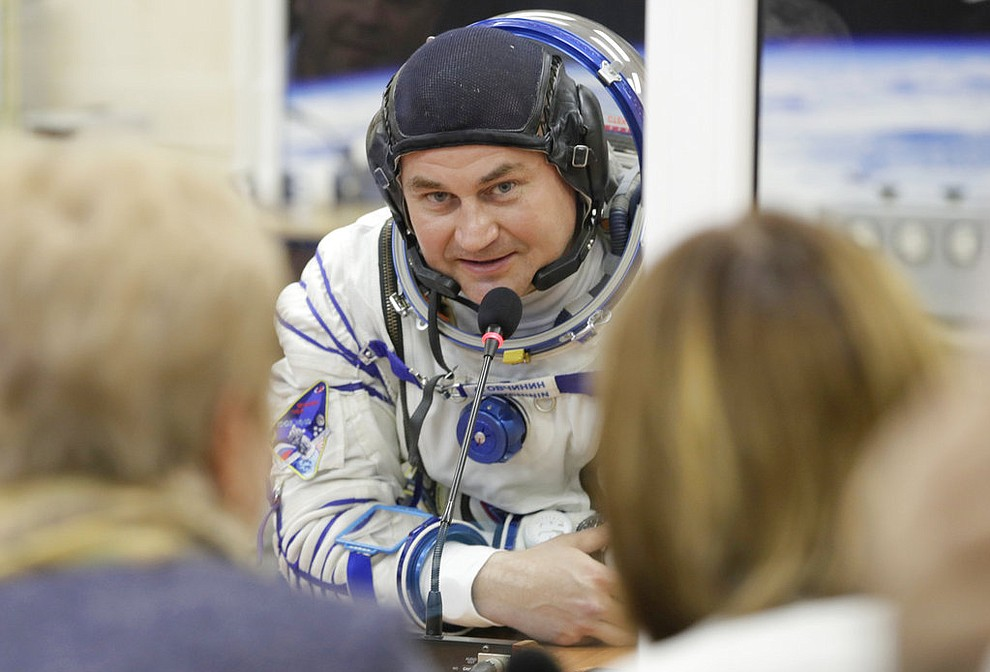 Russian cosmonaut Alexey Ovchinin, a member of the main crew of the expedition to the International Space Station (ISS), speaks with his relatives through a safety glass prior to the launch of Soyuz MS-10 space ship at the Russian leased Baikonur cosmodrome, Kazakhstan, Thursday, Oct. 11, 2018. (AP Photo/Dmitri Lovetsky)