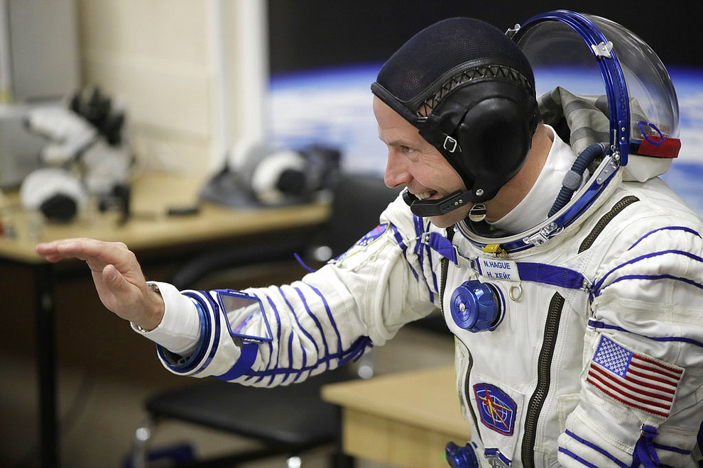 U.S. astronaut Nick Hague, a member of the main crew of the expedition to the International Space Station (ISS), gestures prior to the launch of Soyuz MS-10 space ship at the Russian leased Baikonur cosmodrome, Kazakhstan, Thursday, Oct. 11, 2018. (AP Photo/Dmitri Lovetsky)