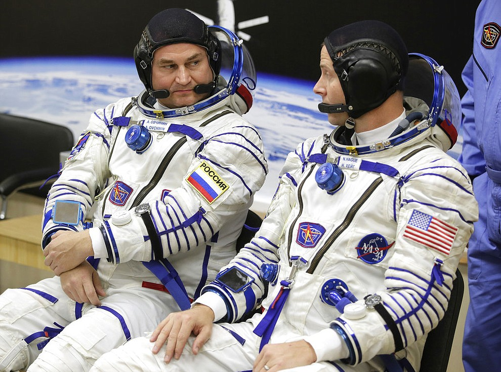 U.S. astronaut Nick Hague, right and Russian cosmonaut Alexey Ovchinin, member of the main crew of the expedition to the International Space Station (ISS), speak prior to the launch of Soyuz MS-10 space ship at the Russian leased Baikonur cosmodrome, Kazakhstan, Thursday, Oct. 11, 2018. (AP Photo/Dmitri Lovetsky)