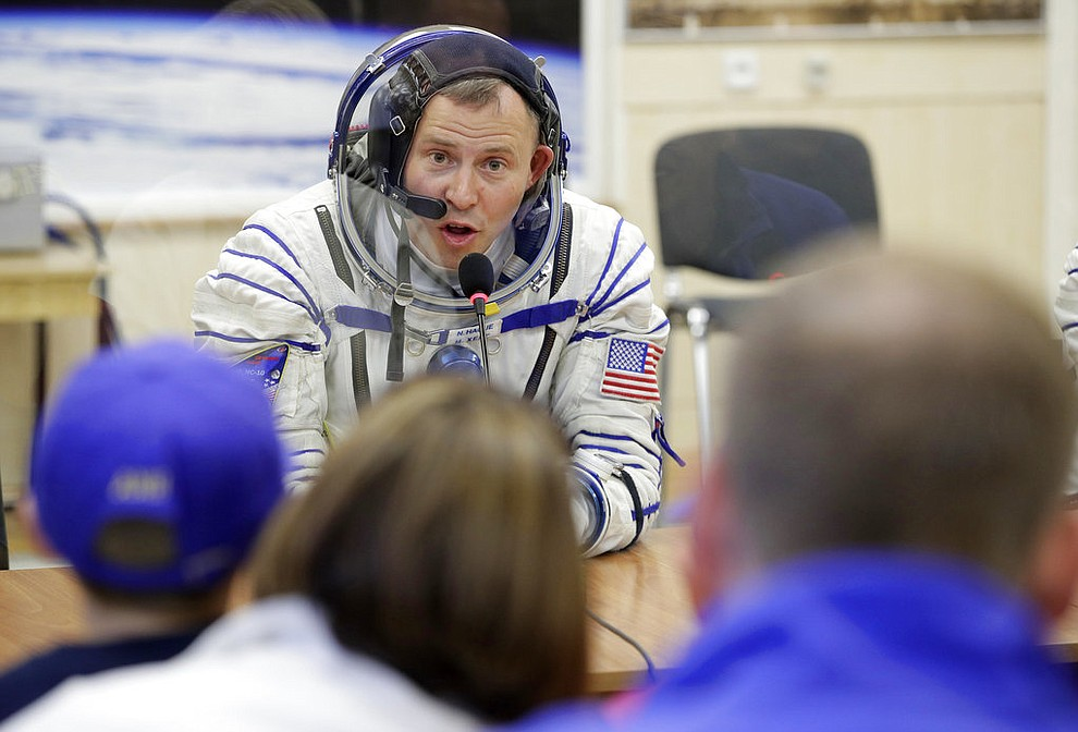 U.S. astronaut Nick Hague, a member of the main crew of the expedition to the International Space Station (ISS), speaks with his relatives through a safety glass prior to the launch of Soyuz MS-10 space ship at the Russian leased Baikonur cosmodrome, Kazakhstan, Thursday, Oct. 11, 2018. (AP Photo/Dmitri Lovetsky)