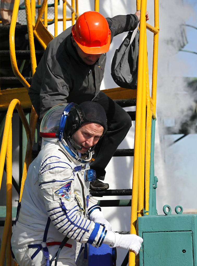 U.S. astronaut Nick Hague, crew member of the mission to the International Space Station, ISS, boards the rocket prior to the launch of Soyuz-FG rocket at the Russian leased Baikonur cosmodrome, Kazakhstan, Thursday, Oct. 11, 2018. (AP Photo/Yuri Kochetkov, Pool)