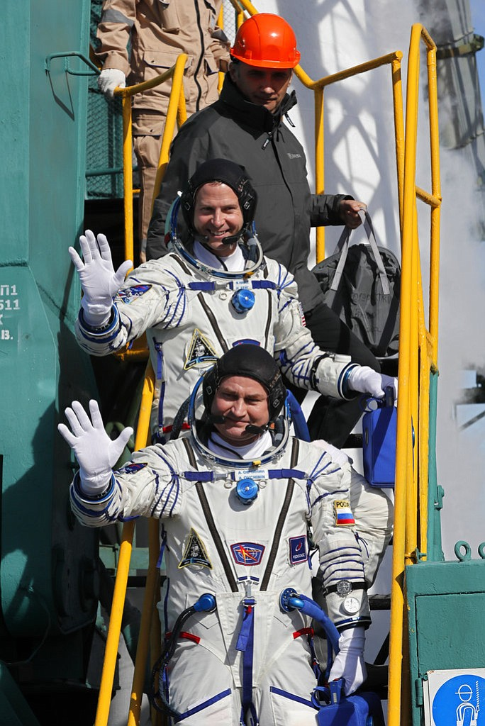 U.S. astronaut Nick Hague, right, and Russian cosmonaut Alexey Ovchinin, crew members of the mission to the International Space Station, ISS, wave as they board to the rocket prior the launch of Soyuz-FG rocket at the Russian leased Baikonur cosmodrome, Kazakhstan, Thursday, Oct. 11, 2018. (Yuri Kochetkov, Pool Photo via AP)