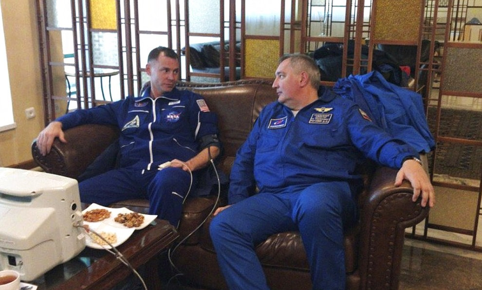 CORRECTS TO ROSCOSMOS DIRECTOR DMITRY ROGOZIN FROM ROSCOSMOS COSMONAUT ALEXEY OVCHININ - In this photo provided by Roscosmos, NASA Astronaut Nick Hague, left, and Roscosmos Director Dmitry Rogozin sit in Dzhezkazgan, Kazakhstan on Thursday, Oct. 11, 2018, after an emergency landing following the failure of a Russian booster rocket carrying them to the International Space Station. (Roscosmos via AP)