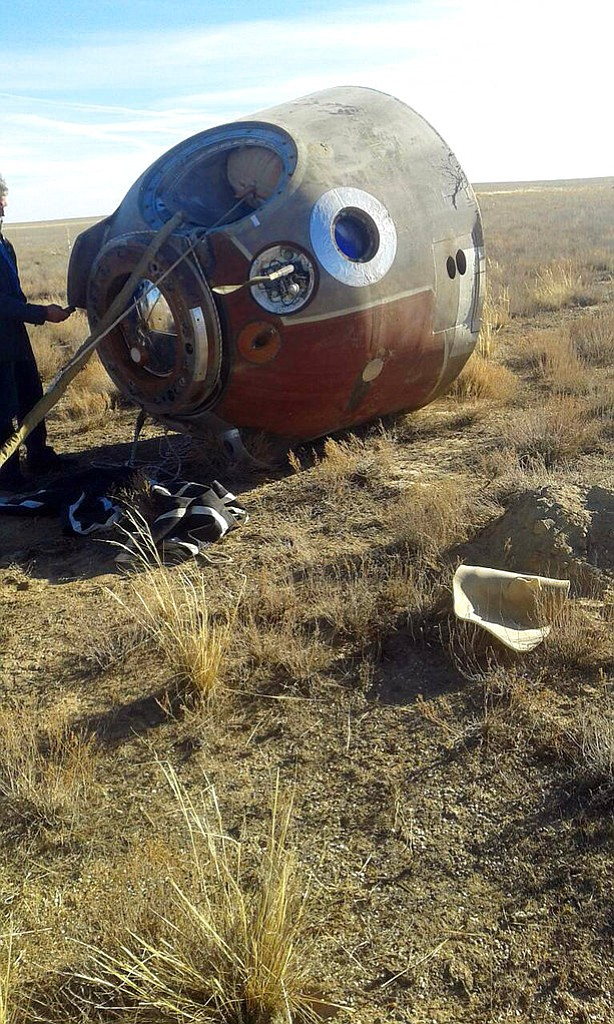 In this photo provided by Russian Defense Ministry Press Service, the Soyuz MS-10 space capsule lays in a field after an emergency landing near Dzhezkazgan, about 450 kilometers (280 miles) northeast of Baikonur, Kazakhstan, Thursday, Oct. 11, 2018. NASA astronaut Nick Hague and Roscosmos' Alexei Ovchinin lifted off as scheduled at 2:40 p.m. (0840 GMT; 4:40 a.m. EDT) Thursday from the Russian-leased Baikonur cosmodrome in Kazakhstan, but their Soyuz booster rocket failed about two minutes after the launch. (Russian Defense Ministry Press Service photo via AP)