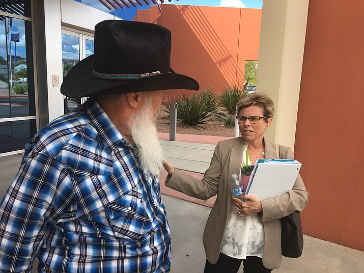 Supervisor Hildy Angius discusses the formation of the Mohave County Public Lands and Recreation Commission with Ric Swats, a Golden Valley resident who was appointed Monday as one of the commissioners. (Photo by Hubble Ray Smith/Daily Miner)