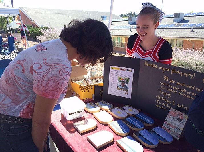 Hannah Irvine shows off her fundraising project for the Sacred Service Marketplace during the 2016 Sacred Heart Heritage Festival. (Courtesy)