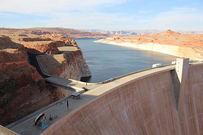 Lake Powell stores Colorado River water behind Glen Canyon Dam, completed in 1966 near Page. After decades of drought and population growth, the reservoir is at less than half its capacity. (Luke Runyon/KUNC)