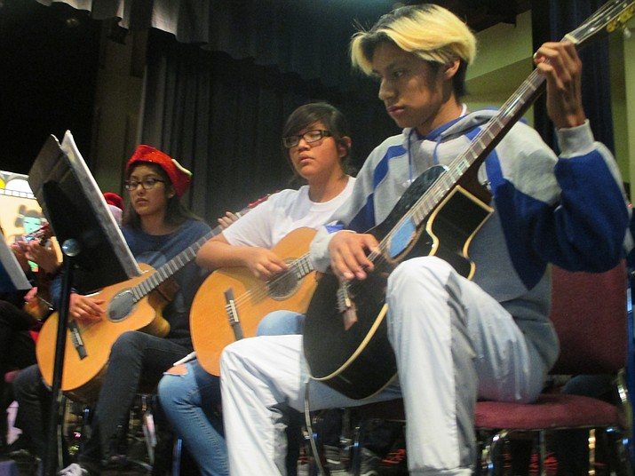 The advanced guitar class wil perform at the coffee house at Hopi High School Oct. 17 in the cafeteria. From left: Advanced guitar students Sierra Ramirez, Christina Shupla and Martin Foley. (Stan Bindell/NHO)