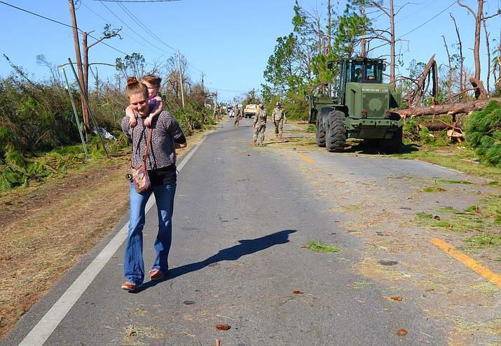 Soldiers of the 753rd Brigade Engineer Battalion, Alpha Co., from Tallahassee, Florida, clears the roadways for residents to pass through as a result of Hurricane Michael, Oct. 13, 2018, in Panama City, Florida. The Florida National Guard's year-round training anticipates Florida's needs and challenges before an emergency occurs