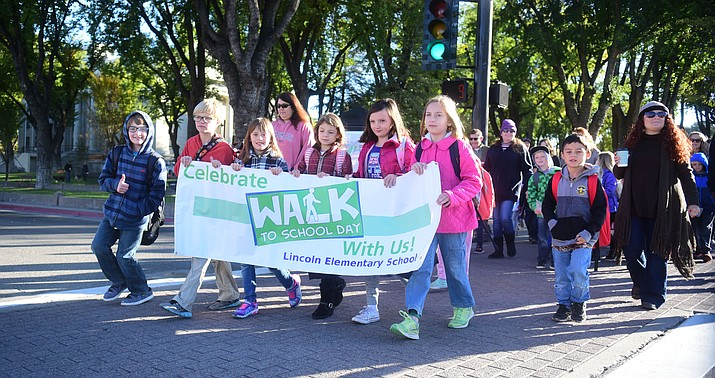 Students from Prescott's Lincoln School walk down Goodwin Street as part of Walk to School week Wednesday, Oct. 17, 2018. (Les Stukenberg/Courier)