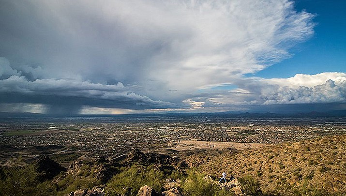 Clouds spun off from Hurricane Rosa move over the metro Phoenix as seen from South Mountain. This month already is the wettest October on record, and mor erain is in the forecast. (Photo by Jordan Evans/Cronkite News)
