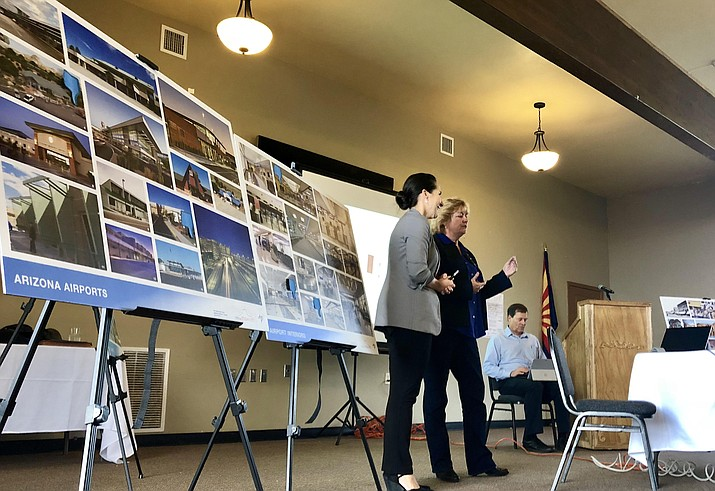 Consultant architect Sandra Kukla, left, and Prescott Airport Director Robin Sobotta present information to the audience during an open-house meeting Tuesday, Oct. 16, 2018, at the city's Centennial Center about the future of the Prescott Airport. The presentation included examples of other airport terminal designs around the country. (Cindy Barks/Courier)