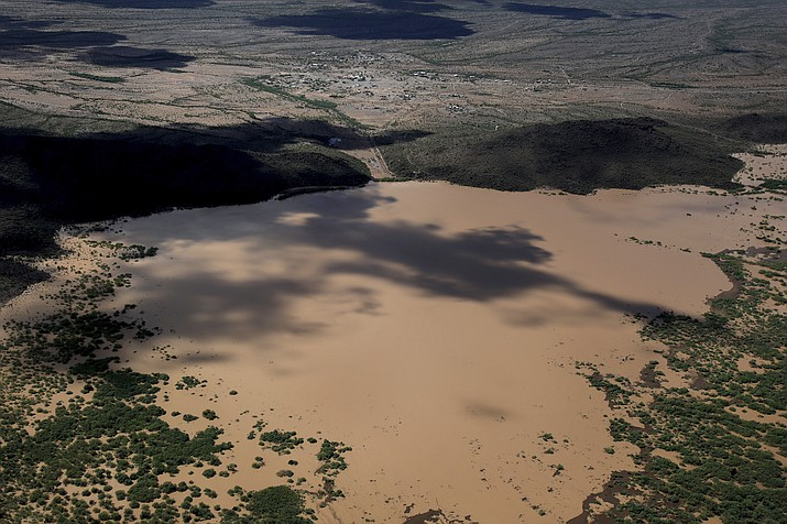 The earthen Menagers Dam that was in imminent danger of failing, potentially sending floodwaters rushing into the Tohono O'odham village of Ali Chuk, southwest of Sells, Ariz., is shown on Wednesday, Oct. 3, 2018. (Mike Christy/Arizona Daily Star via AP)