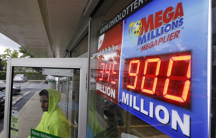 The Mega Millions jackpot is displayed as a customer leaves the Corner Market, Wednesday, Oct. 17, 2018, in Lyndhurst, Ohio. The next drawing will be Friday. (Tony Dejak/AP)