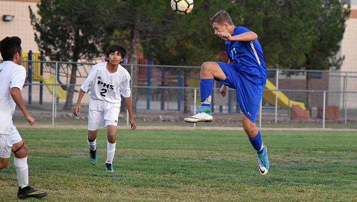 Cowboys boys soccer bounces back to rout Page, eyes home playoff game