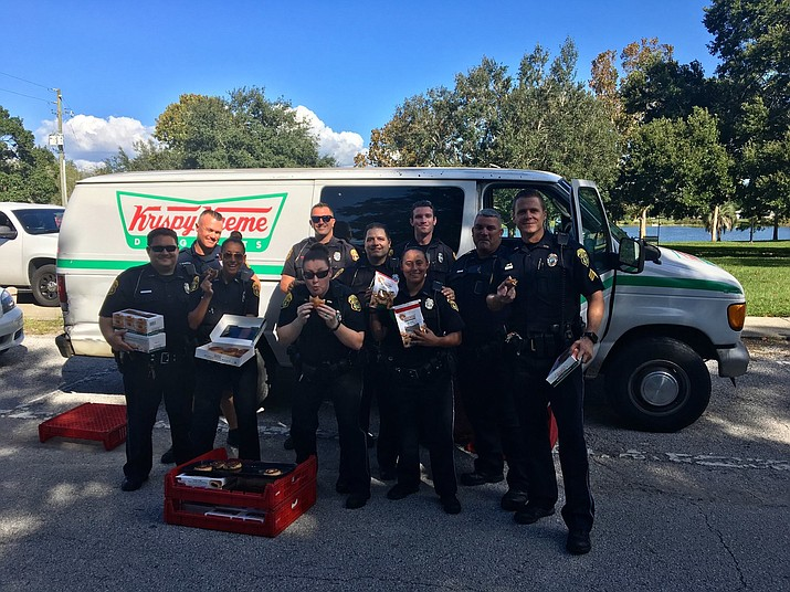 Clearwater police officers recovered a stolen van filled with Krispy Kreme doughnuts. The store manager donated the cargo of doughnuts to the officers. They saved some doughnuts to eat and handed out the rest to the area's homeless. (Clearwater Police Department)