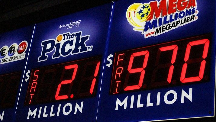 The Mega Millions jackpot is displayed at Short Stop on Harrison Street. The next drawing is today. (Photo by Vanessa Espinoza/Daily Miner)