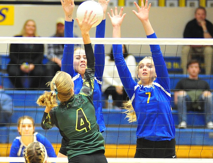 Prescott's Helen Burger and Katharine Radavich go for a block as the Badgers host Flagstaff on Thursday, Oct. 18, 2018, in Prescott. The Badgers lost 3-1. (Les Stukenberg/Courier)
