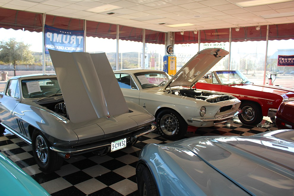 A 1964 fuel-inject Corvette and Shelby GT 500 are two of the higher-end classics on display in Dunton Motors' showroom, which attracts tourists looking for photo opportunities.