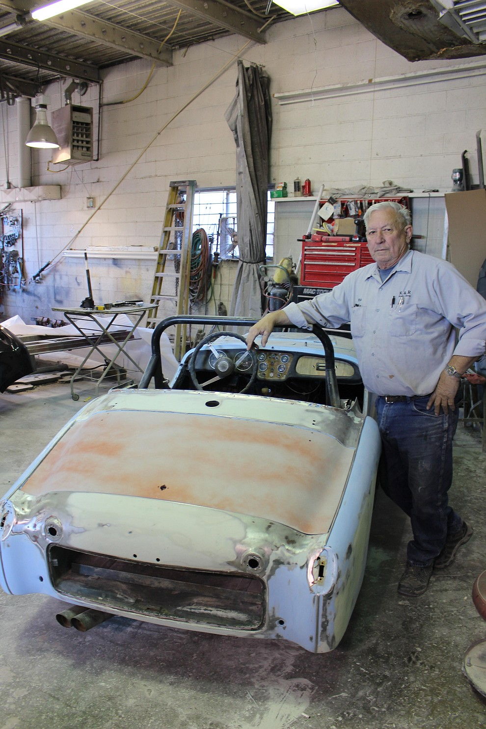 Rick Rice, owner of R&R Body Shop on Andy Devine Avenue, said restoring classic cars like this 1952 Triumph can cost more than people think.