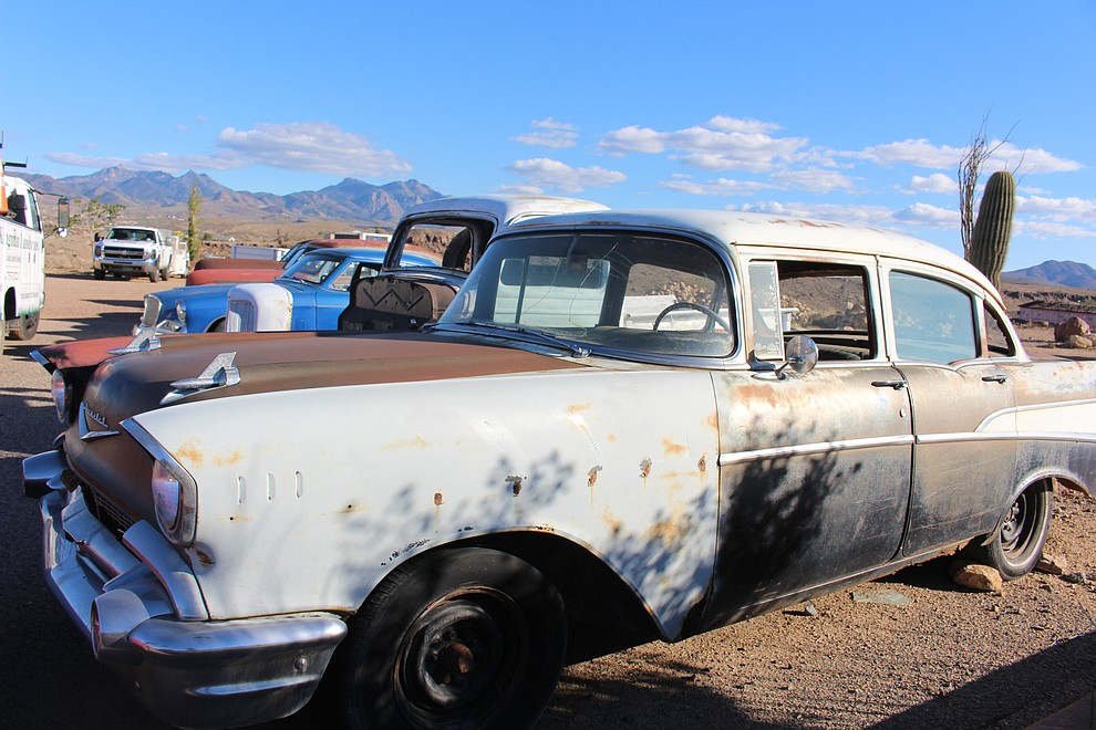A 1957 Chevrolet Bel Air sits on the lot of Kingman Landscape and Maintenance atop El Trovatore Hill, among several project cars awaiting restoration.
