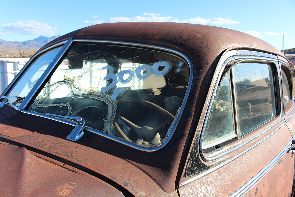 The windshield is smashed on a '41 Oldsmobile that Chris Burkett found in Arkansas and is selling for $3,000 on his lot at Kingman Landscape and Maintenance.