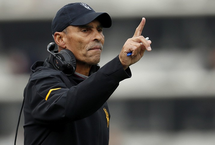 In this Saturday, Oct. 6, 2018, file photo, Arizona State head coach Herm Edwards gestures during the first half of an NCAA college football game in Boulder, Colo. Arizona State got off to a strong start in its first season under Herm Edwards, opening with two victories, including one over then-ranked Michigan State. (AP Photo/David Zalubowski/AP, file)