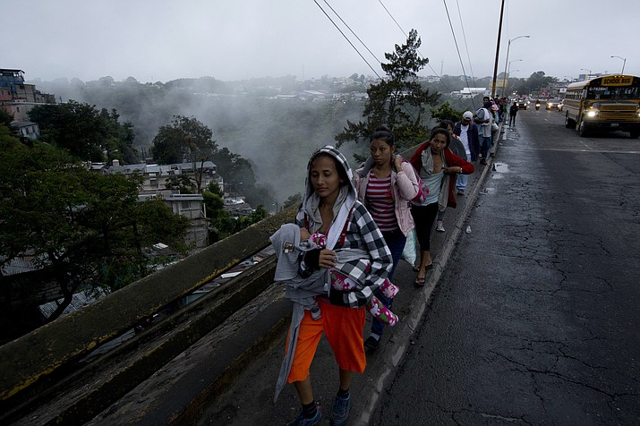 Honduran migrants leave Guatemala City at sunrise Thursday, Oct. 18, 2018, as they continue their way north toward the U.S. Many of the more than 2,000 Hondurans in a migrant caravan trying to wend its way to the United States left spontaneously with little more than the clothes on their backs and what they could quickly throw into backpacks. (Moises Castillo/AP)