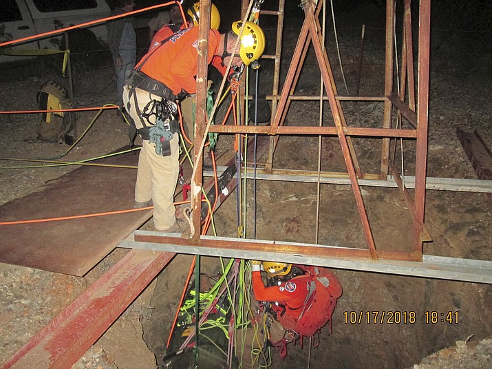 Maricopa County Sheriff's Office shows a rescue team lowering themselves into an old abandoned mine shaft on Oct. 17, 2018, to rescue a man who fell into the shaft on Monday, Oct. 15, 2018, the near Aguila, Ariz. A hospital spokeswoman said the man who fell into the old abandoned mine shaft is in good condition awaiting surgery for two broken legs. (Maricopa County Sheriff's Office via AP)